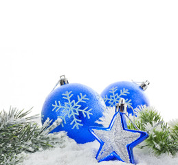 Christmas blue baubles and snowflakes on white background