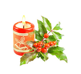 Christmas burning red candle and holly tree isolated