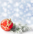 Christmas branch of tree red bauble snow background
