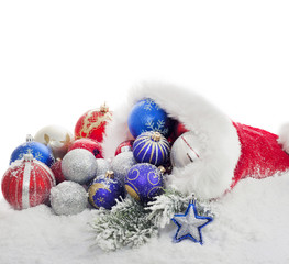 Christmas baubles and gift in santa claus hat