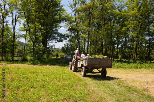 Family of farmers on a tractor