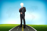 A business man bulb standing over road and blue sky the backgrou