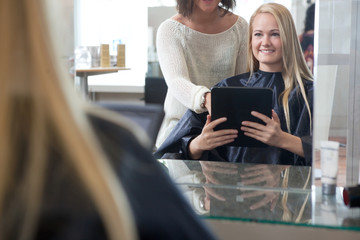 Customer Showing Hair Style on Digital Tablet