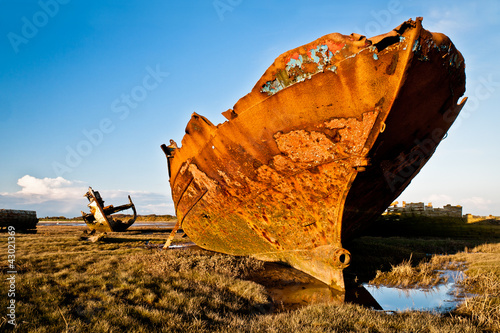 Rusting trawlers on salt marsh at Fleetwood UK