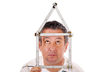 Man with a ruler shaped into a house