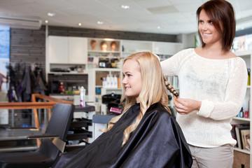 Hairdresser Curling Customer's Hair