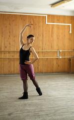 young ballet girl at ballet school class