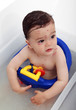 Baby suffering with chickenpox having bath
