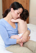 Mum cuddling baby with chickenpox