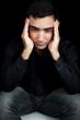 Hispanic man suffering a strong headache or depression