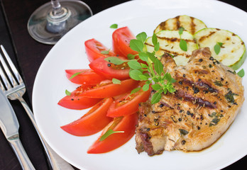 Juicy grilled steak  with vegetables