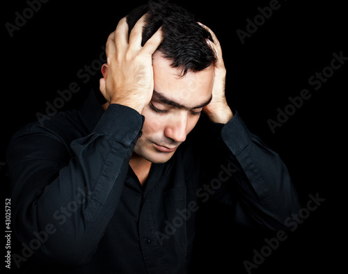 Hispanic man suffering a strong headache or depression