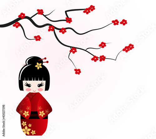 Kokeshi doll under sakura branch