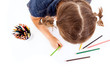 Top view of cute child draw with colorful crayons, isolated over
