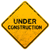 Dirty Under Construction Sign