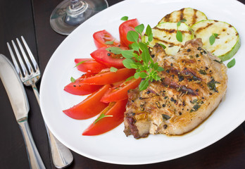Hearty pork steak with vegetables