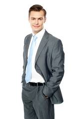 Smiling entrepreneur posing with hands in pocket
