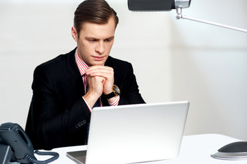 Serious businessman concentrating