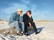 Постер, плакат: Two Bored Retired Men Sitting Together at the Beach