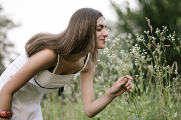 Girl smelling flowers