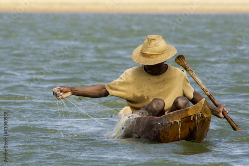 Malgasy fisherman in a pirogue.