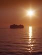 sunset and cruise ship