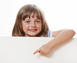happy little girl holding  white board with empty space for text
