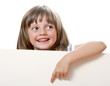little girl pointing on  white empty board