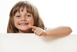 happy little girl holding  white board with empty space