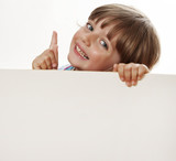 little girl pointing and white empty board