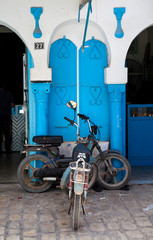 Decorative traditional Tunisian door, with moped