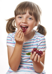 happy little girl eating cherries