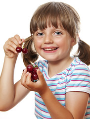 little girl with cherries on white background