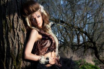 Portrait of romantic woman in fairy forest. Renaissance style