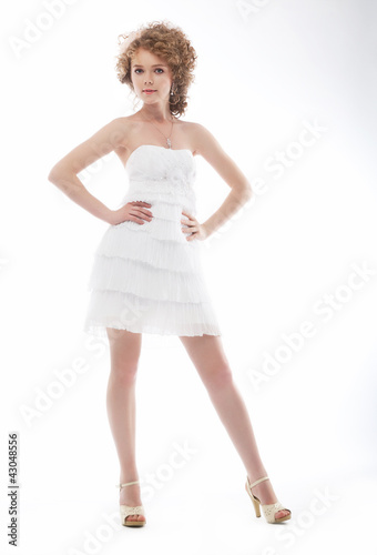 Beauty young bride in elegant white short wedding dress