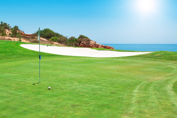 Golf course on the background of the sea. Summer.