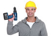 Tradesman holding up a screw gun
