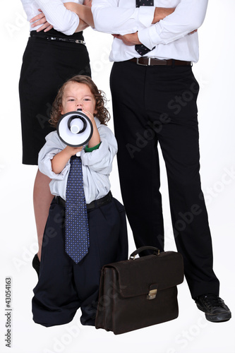 little boy protesting against business people
