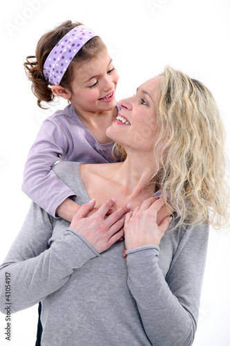 portrait of happy young mother and daughter