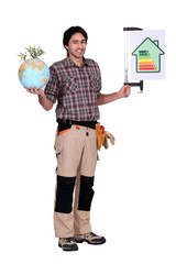 Man holding a globe and a sign for energy consumption