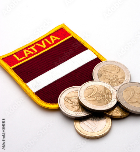latvia flag and euro coins