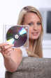 Teenager showing CD