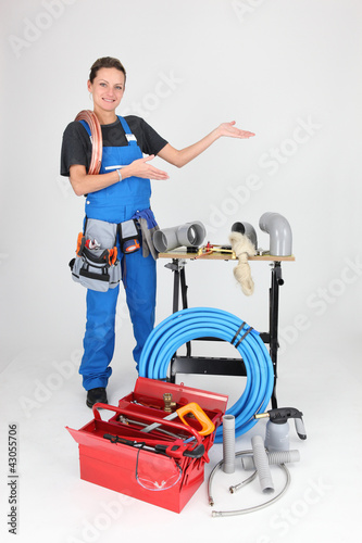 woman plumber showing