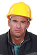 Sad man in a hard hat