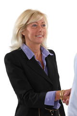 Woman shaking hands with a client