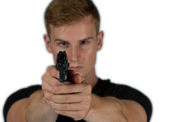 Close up of a man aiming his weapon at you