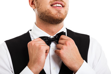 Waiter adjusting his necktie