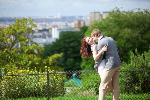 Happy laughing couple is hugging on Montmartre