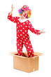 A smiling clown coming out of a cardboard box