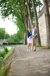 Cheerful couple is dancing on the Seine embankment in Paris